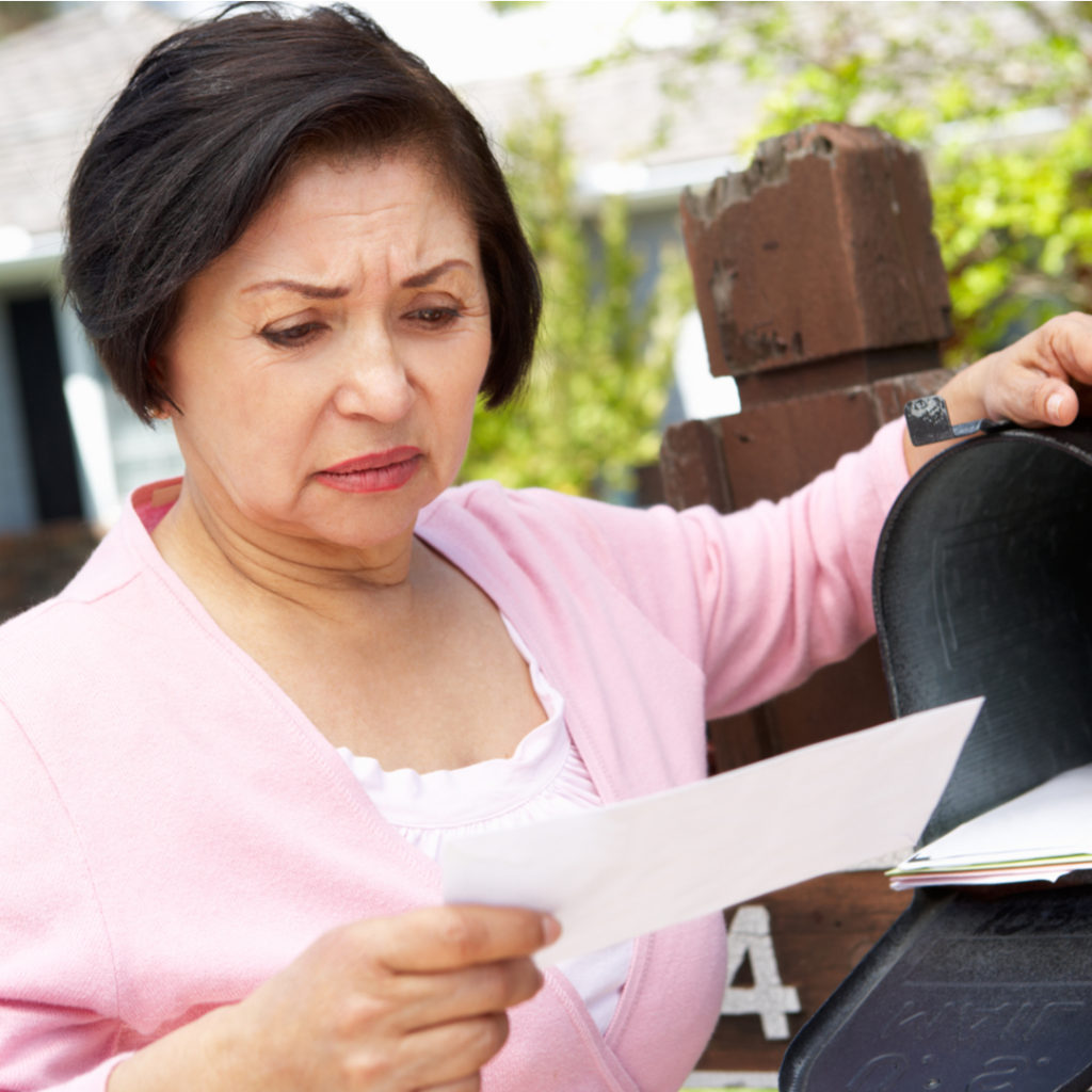 Photo of someone who received a notice from the IRS   White Income Tax