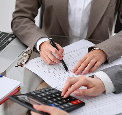 Photo of two accountants filing taxes | White Income Tax