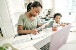 Woman with her child, working on tax preparation in Peoria IL