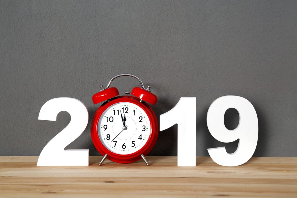 The year 2019 with a red alarm clock as the zero